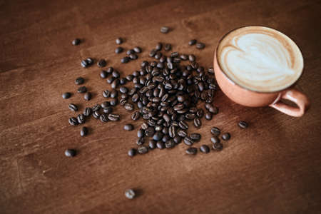 cup of cuppuchino and beans of coffee. complex and nuanced flavor of good coffee.Step by step tips of coffee making.recipe