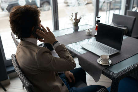 young businessman making appointment.close up back view photo, gadget, conversation concept Imagens