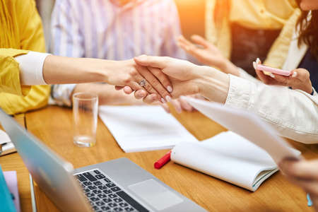 Cropped image of young women shaking hands, success, agrement. agreement. two companies negotiating a contract.