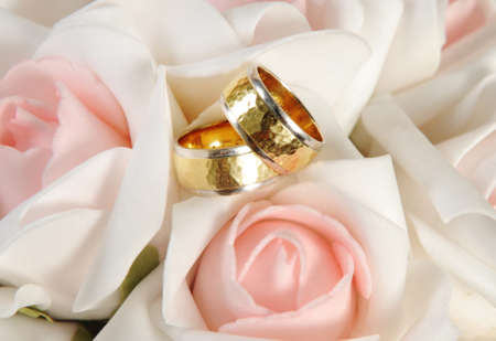 gold rings and flowers Stock Photo