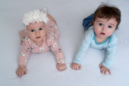 Brother and sister. Twins. Two adorable twin babies smiling happily. Positive lifestyle concept. Happy childhood. View from above Foto de archivo