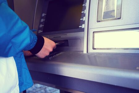 the girl raises money from the ATM - Image
