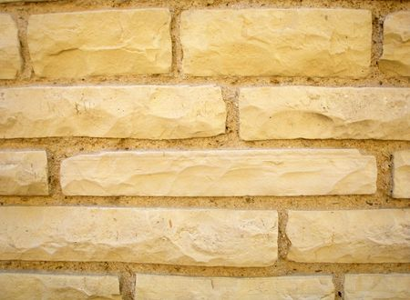 Yellow brick wall background. Brick texture.         photo