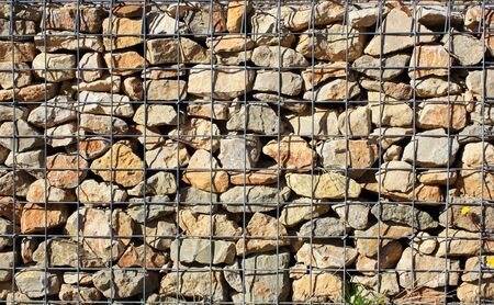 uncouth: Stone wall with iron bars