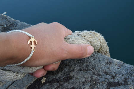 Hand holding on to the rope