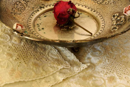 seder plate: Part of an antique plate with a rose inside Stock Photo