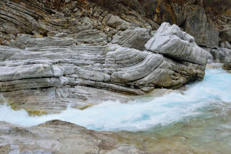 decades: Very Particular white river rocks carved by decades of water turques