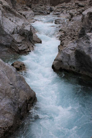 Very Particular white river rocks carved by decades of water turques