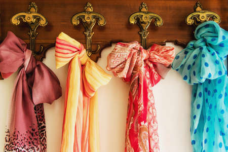 fabric textures: Colored scarves on antique hanger