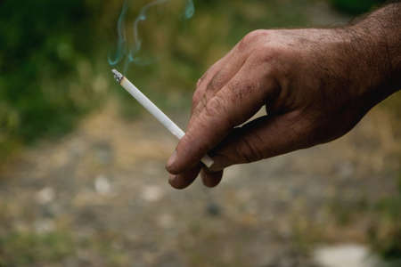Holding the cigarette