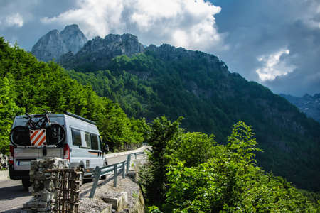 Traveling on the mountain with the camper Banco de Imagens