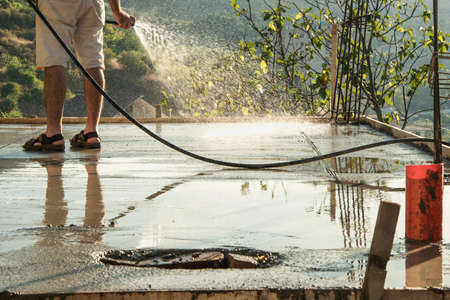 consolidated: Pouring water on reinforcement cement