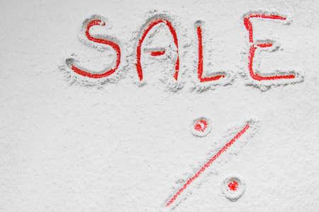 Written SALE% on the snow