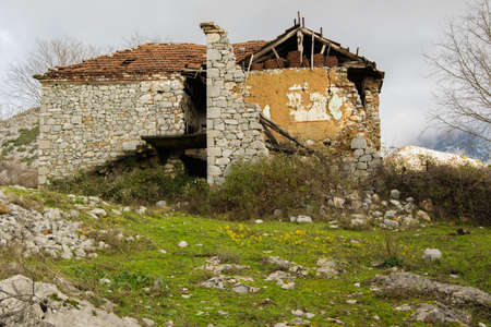 An abandoned house in the mountains. The migration of the people and the abandonment of their homes Stock Photo