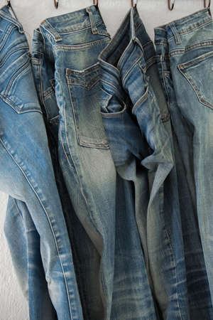 Fashion background of blue jeans on a hanger, business fashion concept