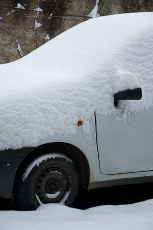 Parked car covered by the snow, space for text Stock Photo