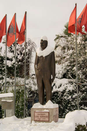 Statue covered with snow of Luigj Gurakuqi - albanian writer and politician
