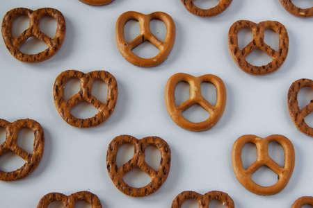Food pattern- salty snacks/crisps on white background