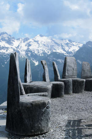 Ancient handmade wooden chairs, located in the high mountains to admire the beauty of nature, Albania