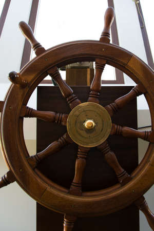 Front view of wooden rudder on a sailing ship inside the capitans cabin