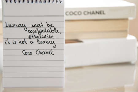 Coco Chanel quotes written on a block note, inspiration phrase