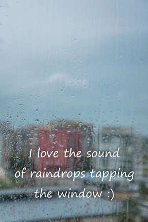 Rain drops on window with text - I love the sound of raindrops tapping the windows Stock fotó