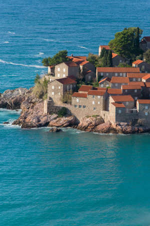 Sveti Stefan island - resort of Montenegro, near Budva, a charming seaside hideaway resort with lush grounds and stunning Adriatic sea views.