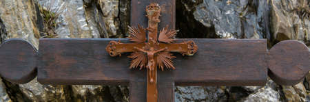 Close up of Jesus Christ cross, stone background