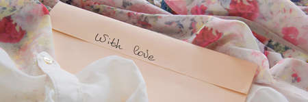 Pastel color envelope on a silky cloth, romantic love concept