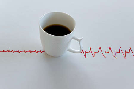 Coffee cup with electrocardiogram lines on white background