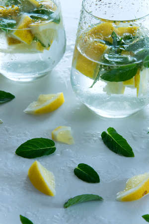 Refreshment ice drinkcocktail with raw lemons and mint