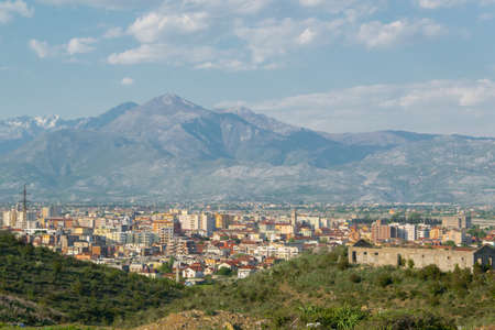 Albanian city Shkoder cityscape with mountain background