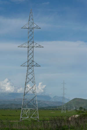 Transmission tower or power tower in high-voltage, Albania landscape background