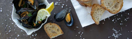 Cooked delicious black mussel with toasted bread. Healthy eating concept, rich protein  food Stock Photo