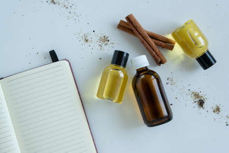 Top view of bottles with cinnamon essential oil. Healthy cosmetic product