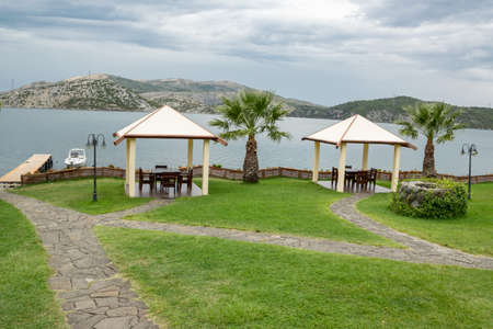 Summer pavilions in the garden with relaxing lake view. Exterior design