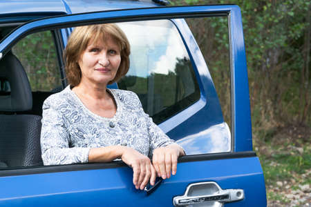 Attractive senior lady traveling with automobile. Active lifestyle concept 스톡 콘텐츠