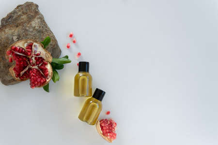 Top view of bottles with pomegranate seed essential oil. Massage cosmetic treatment