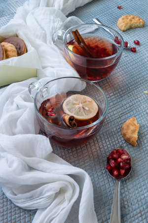 Refreshment time, Tasty homemade biscuits and pomegranate  tea Banco de Imagens - 133078334