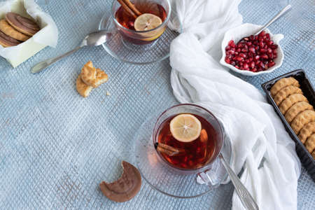Refreshment time, Tasty homemade biscuits and pomegranate tea Banco de Imagens - 133168105