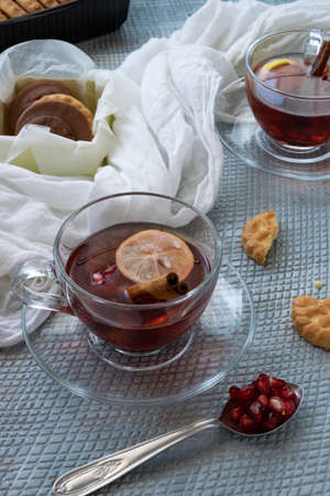 Refreshment time, Tasty homemade biscuits and pomegranate tea Banco de Imagens - 133168490