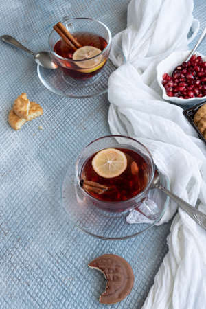 Refreshment time, Tasty homemade biscuits and pomegranate tea Banco de Imagens - 133168221