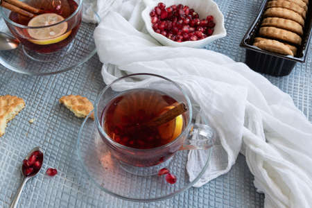 Refreshment time, Tasty homemade biscuits and pomegranate tea Banco de Imagens - 133168426