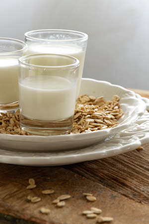 Fresh oat milk drink. Healthy nutritional ingredient, dairy themes