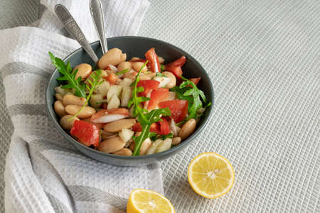 Ready to eat beans salad, healthy protein rich meal with fresh arugula leaves Stok Fotoğraf