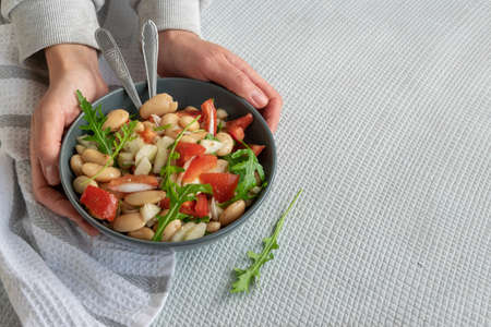 Ready to eat beans salad, healthy protein rich meal with fresh arugula leaves Фото со стока