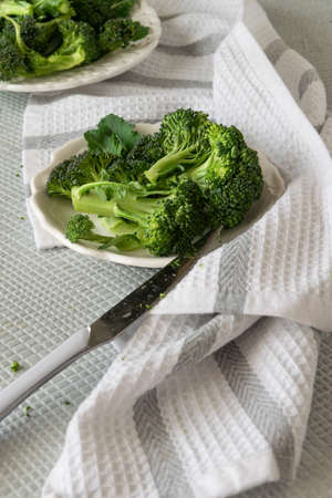 Preparing raw broccoli florets for cooking, cooking fresh vegetables, healthy ingredient, still life Stok Fotoğraf