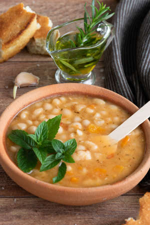 Served traditional hot beans soup with corn bread, garlic and olive oil. Vegetarian healthy dish, vegan food