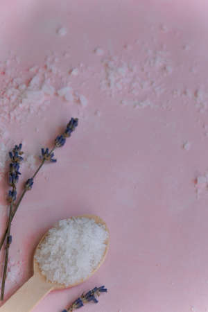 Natural wellness beauty ingredients on pink background. Health care spa therapy with sea salt and lavender,  super food for the skin