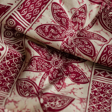Folded oriental cloth. Crop view of fashioned ethnic fabric